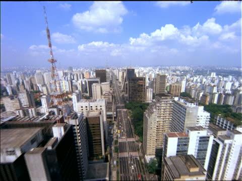 vídeos de stock, filmes e b-roll de aerial point of view wide city streets + buildings / paulista avenue, sao paulo, brazil - 1990
