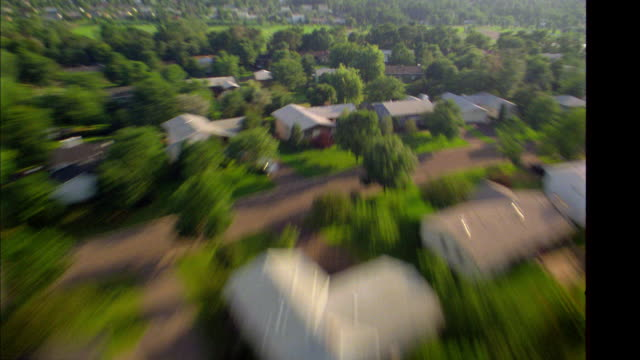 fast motion aerial point of view wide shot over suburban neighborhood / minnesota - minnesota bildbanksvideor och videomaterial från bakom kulisserna