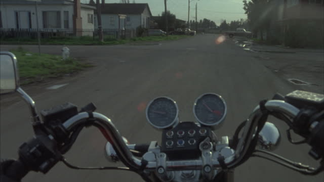 point-of-view driving a motorcycle through a rundown residential area. - bad condition stock videos and b-roll footage