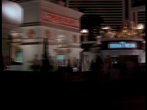 point-of-view from the passenger side of a car passing through the streets of las vegas. - bus billboard stock videos & royalty-free footage