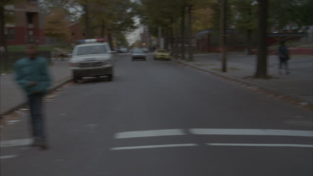 Point-of-view of a slow drive through a Philadelphia housing project.