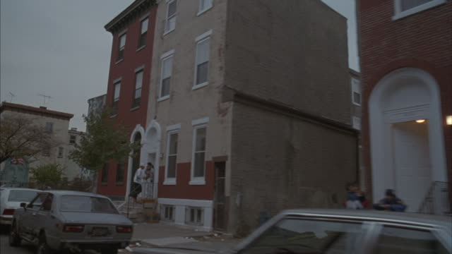 Point-of-view of a slow drive through one of Philadelphia's lower-middle-class neighborhoods.
