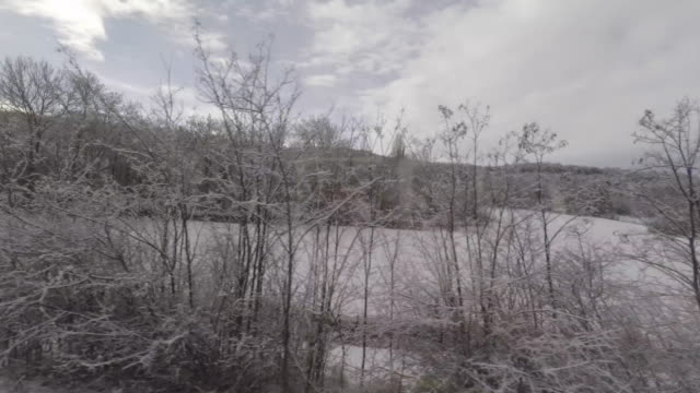 point-of-view of the countryside with snow from a moving train - train point of view stock videos & royalty-free footage