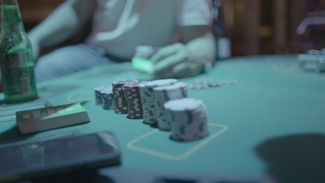 poker game being played under strobe lights in slow motion - gambling chip stock videos and b-roll footage