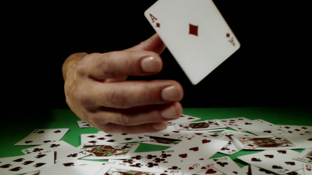 slo mo poker player catching aces - hand of cards stock videos & royalty-free footage