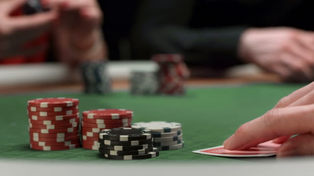 hd: poker player raise bet - gambling chip stock videos & royalty-free footage