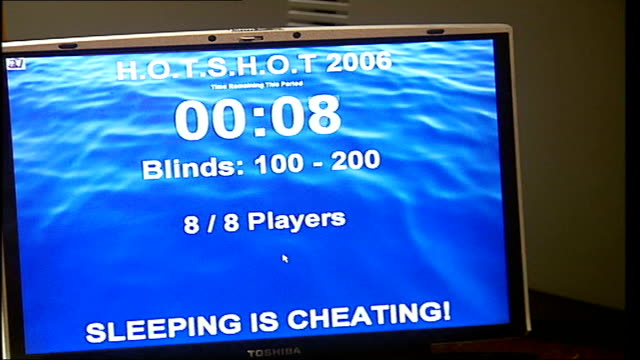 poker players attempt new world record for longest game; england: london: greenwich: int people playing poker game - as trying to break world record... - スコアボード点の映像素材/bロール