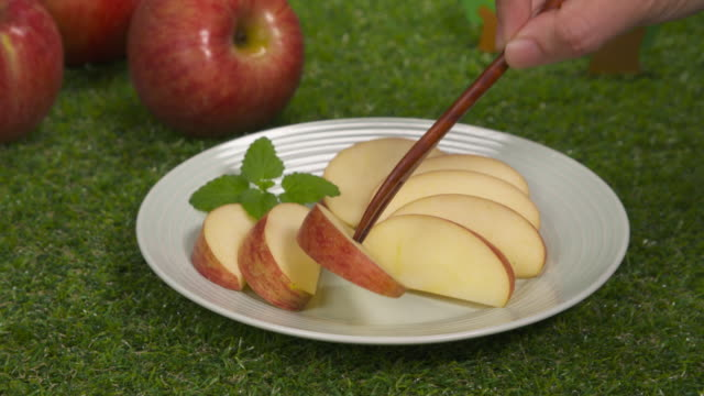 poking a slice of apple with a fork / south korea - slice stock videos & royalty-free footage
