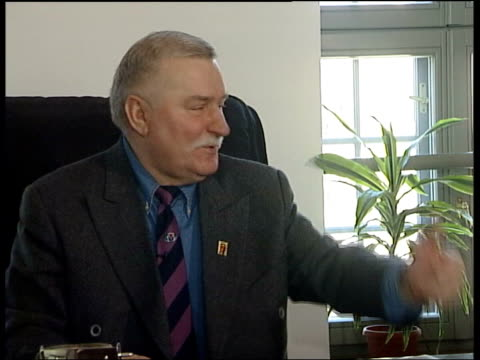Poland prepares to join the EU ITN Gdansk INT Walesa getting up from desk to greet Neely CS Trade Union pin on tie Lech Walesa interviewed SOT...