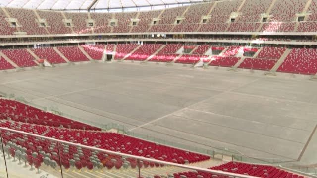 poland's national stadium will double as a field hospital for warsaw as a spike in coronavirus cases has strained health care facilities to the... - warszawa bildbanksvideor och videomaterial från bakom kulisserna