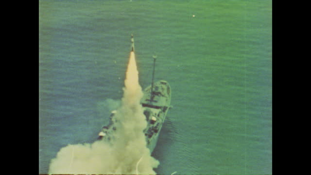 polaris missile is successfully launched from the deck of a converted transport carrier - cuban missile crisis stock videos & royalty-free footage