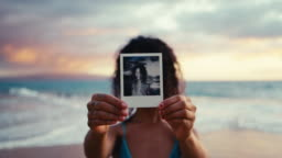 Polaroid portrait of beautiful young woman on the beach at sunset