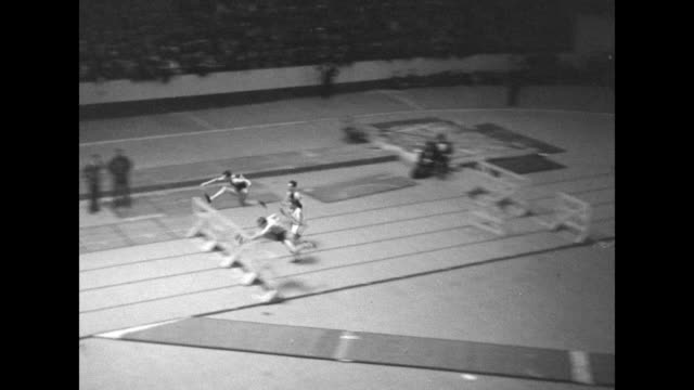 vs pole vaulting during the millrose games at madison square garden / stella walsh wins 50yard dash / monty wells wins 50yard hurdle race / runners... - 1934 stock videos & royalty-free footage