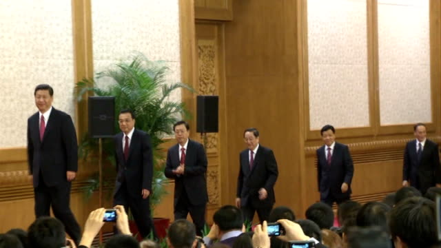 vídeos y material grabado en eventos de stock de police accuse superiors of corruption tx photography *** newly elected chinese leaders onto stage to applause xi jinping speaking at podium - 2012