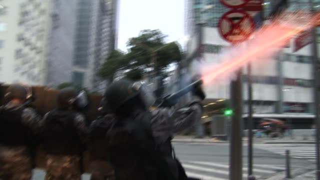 police advance in formation and fire tear gas canisters at protestors. a general strike in opposition to president michel temer's proposed... - tear gas stock videos & royalty-free footage