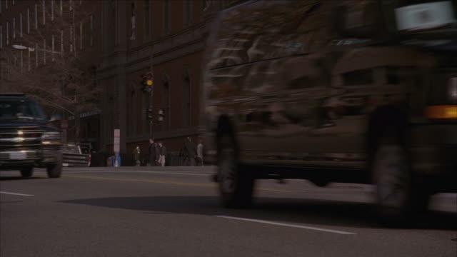 pan police and ambulance driving through street / washington d.c., united states - スウィッシュパン点の映像素材/bロール