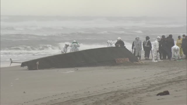 Police and coast guard in the northeastern Japanese prefecture of Yamagata say a wooden boat has washed ashore along the Sea of Japan coast...