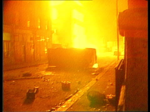 police and criminal evidence bill itn lib london brixton bv policemen with riot shields pull back street with smoke pouring out of building cms side... - criminal stock videos and b-roll footage