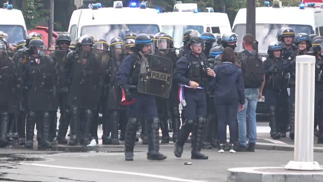 police and demonstrators clashed at protests over france's https://www.gouvernement.fr/en/coronavirus-covid-19 health pass in paris on july 31.... - https stock videos & royalty-free footage