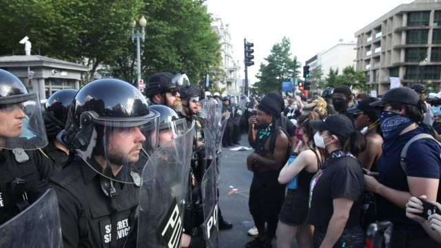police and demonstrators face each other during a protest near lafayette square park on may 30 2020 in washington dc across the country protests were... - lafayette square washington dc stock videos & royalty-free footage