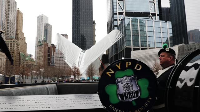 a police and fire department pipes drums band perform at a ceremony at the national september 11 memorial for those killed in the february 26 1993... - fire department of the city of new york stock videos and b-roll footage