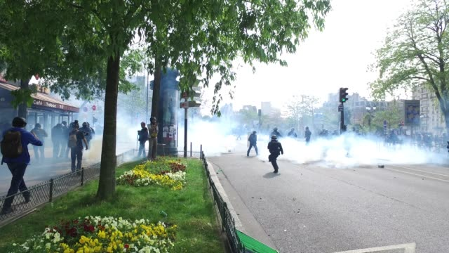 police and fire truck / tear gas / the annual may day protests on may 01, 2019 at boulevard de l'hopital, paris, france / more than 7,400 police and... - may day international workers day stock videos & royalty-free footage