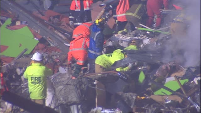 Police and firefighter rescue workers at night attempting to search for survivors at the site of the collapsed Canterbury Television Building New...