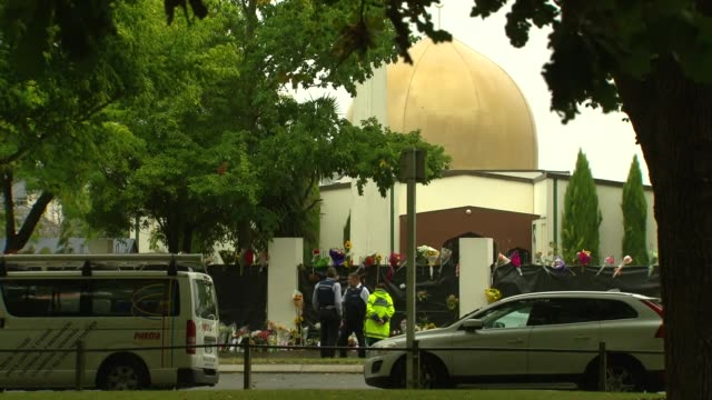 Police and floral tributes outside the Al Noor Mosque in Christchurch New Zealand after a white supremacist gunman carried out a mass shooting