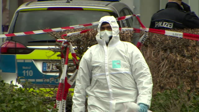 """police and forensic officers at scene of aftermath of terror attack in hanau, germany - """"bbc news"""" stock-videos und b-roll-filmmaterial"""