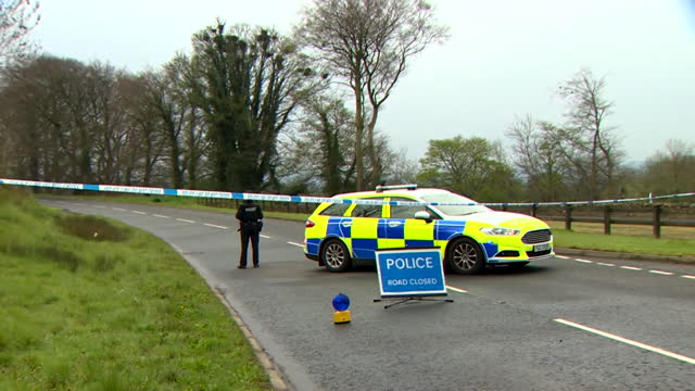 police and forensic officers investigating where a bomb was left outside a police officers house by the dissident republican group, the new ira, in... - forensic science stock videos & royalty-free footage