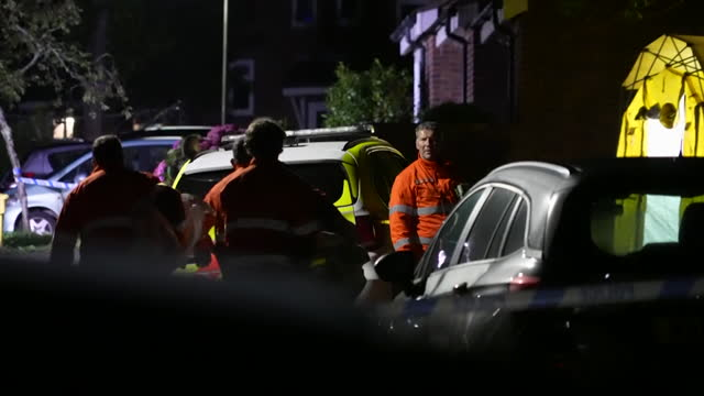 police and forensics officers at the scene of the plymouth shootings at night - boundary stock videos & royalty-free footage