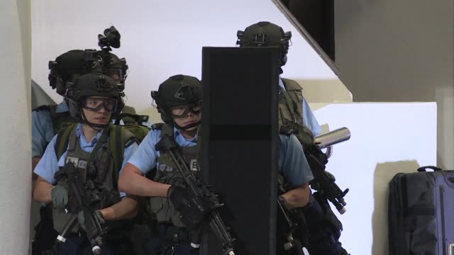 police and members of the civil aid service acting as hostages take part in a counterterrorist training exercise in hong kong - counter terrorism stock videos & royalty-free footage