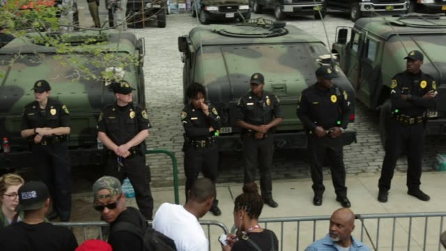 police and members of the maryland national guard form a line in front of the city hall prior to a rally held by black lawyers for justice baltimore... - seilabsperrung stock-videos und b-roll-filmmaterial
