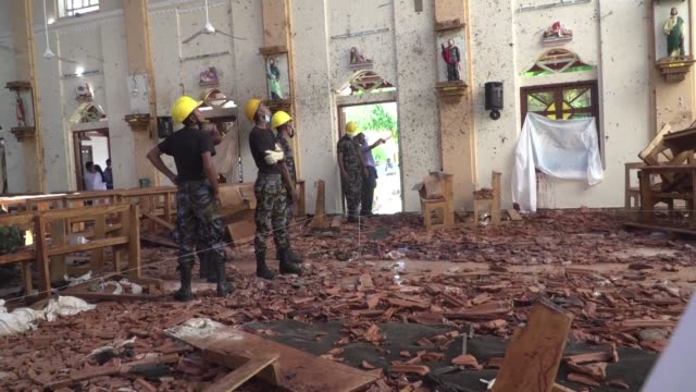 police and military officers continue to inspect the interior of st sebastian's church in negombo and begin to remove debris from the site a day... - sri lanka stock videos & royalty-free footage