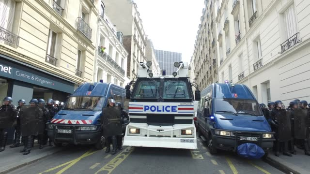 police and mobile gendarmerie / the annual may day protests on may 01, 2019 at rue michel peter paris, france / more than 7,400 police and security... - water cannon stock videos & royalty-free footage