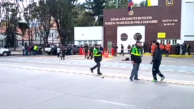 police and rescue services are at the scene an apparent car bomb attack on a police cadet training school in the colombian capital that has left at... - cadet stock videos & royalty-free footage