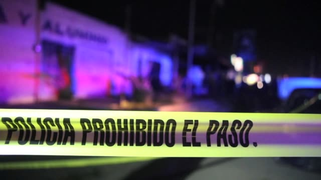 police and rescue services at the scene of a bar in the mexican state of jalisco after it was attacked by unidentified armed men who shot at... - molotov cocktail stock videos and b-roll footage