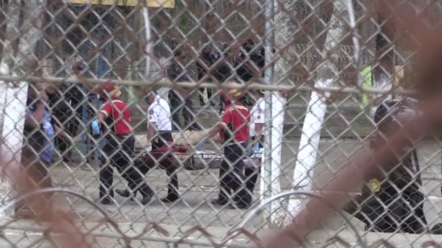 police and rescue services start to gather the dead and treat the injured after a prison riot in southern guatemala that killed at least seven... - authority stock videos & royalty-free footage