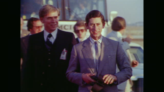 police and secret service mill around prince charles as he exits a car on the runway at edwards air force base with binoculars in hand before... - 1977 stock videos & royalty-free footage