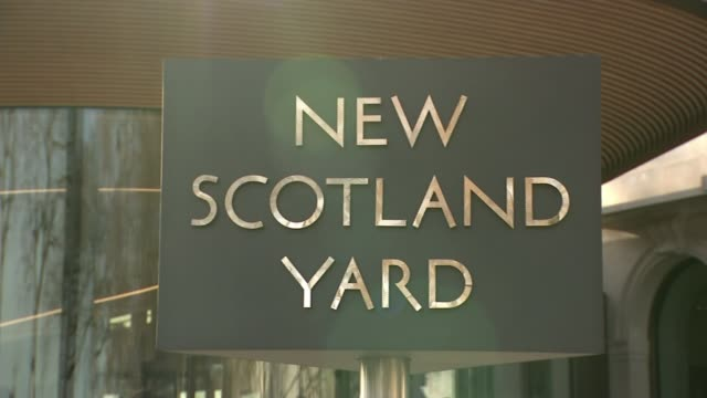 Police apologise to student wrongly charged with rape New Scotland Yard Entrance to building with rotating sign Close shot rotating 'New Scotland...