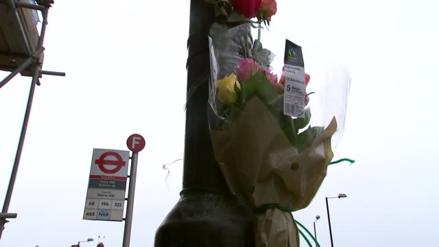 Police appeal for help following New Year knife crime deaths ENGLAND London Tulse Hill EXT Various shots flowers attached to lamppost at site where...