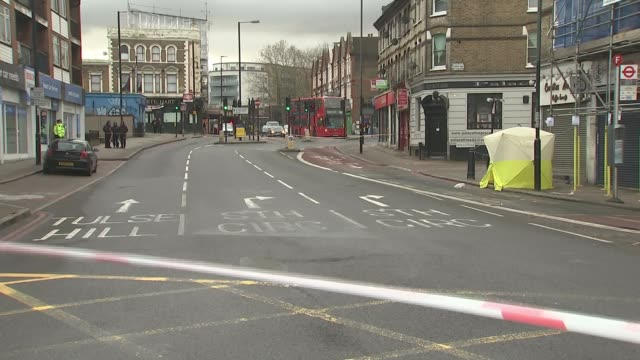 Police appeal for help following New Year knife crime deaths London Tulse Hill General view police cordon at site of Norwood Road stabbing