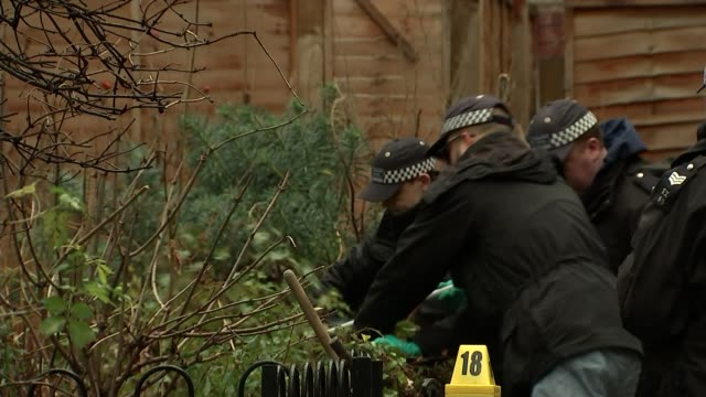 Police appeal for help following New Year knife crime deaths Old Street EXT Various shots police officers and forensics searching through bushes near...
