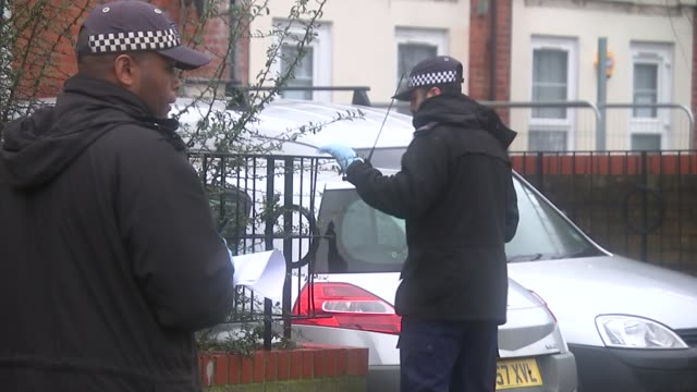 Police appeal for help following New Year knife crime deaths West Ham EXT Police officers at scene of stabbing looking for evidence