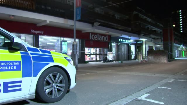 police appeal for witnesses following double stabbing in shadwell england london shadwell iceland shop front and police cordon and items on ground... - mode of transport stock videos & royalty-free footage