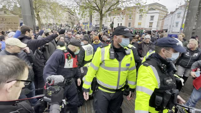 police arrest a man during the anti-lockdown protest on november 14, 2020 in bristol, england. police had warned protesters to cancel the march or... - rebellion stock videos & royalty-free footage