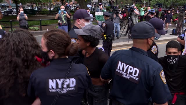 "police arrest a protestor during a ""black lives matter"" demonstration on may 28, 2020 in new york city, in outrage over the death of a black man in... - minnesota stock videos & royalty-free footage"