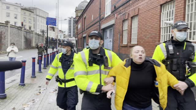 police arrest a woman during the anti-lockdown protest on november 14, 2020 in bristol, england. police had warned protesters to cancel the march or... - politics stock videos & royalty-free footage
