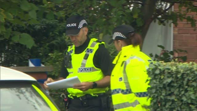 Police arrest more National Action members on antiterrorism charges ENGLAND Warrington EXT House with police outside Police outside house Window with...