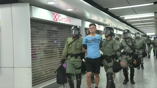 police arrest people believed to be protesters inside a metro station in hong kong after chaos engulfed the heart of hong kong late saturday as... - water cannon stock videos and b-roll footage